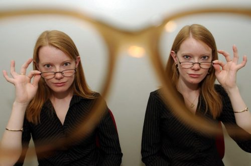 TWINS MYOPIA STUDY PICTURE BY BRIAN SMITH DOZENS OF PAIRS OF TWINS TODAY UNDERWENT EYE TESTS AT ST.THOMAS'S HOSPITAL IN LONDON AFTER NEW RESEARCH THERE HAS INDICATED THAT A GENE CALLED PAX6 MAY PLAY A CRUCIAL PART IN THE DEVELOPMENT OF MYOPIA.PIC SHOWS:IDENTICAL TWINS KATIE(LEFT)AND WENDY THURSTON,19 FROM MILTON KEYNES AT THE HOSPITAL TODAY